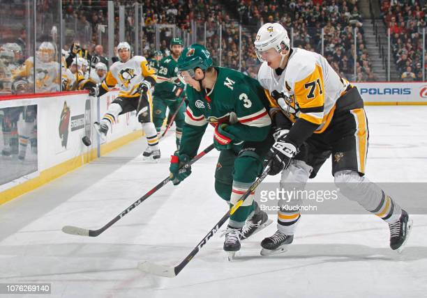 Charlie Coyle of the Minnesota Wild and Evgeni Malkin of the Pittsburgh Penguins battle for position during a game at Xcel Energy Center on December...