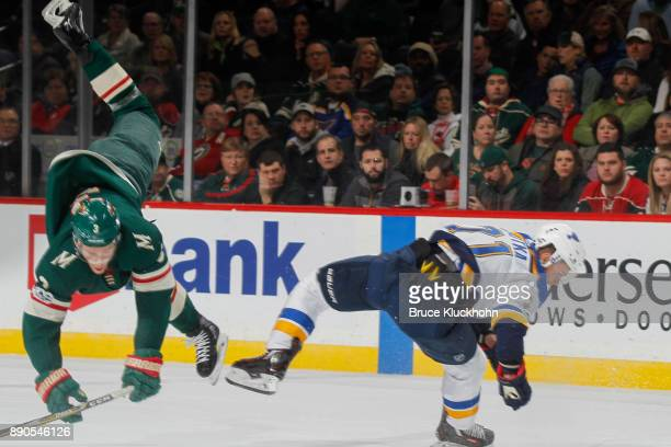 Charlie Coyle of the Minnesota Wild and Vladimir Sobotka of the St Louis Blues collide during the game at the Xcel Energy Center on December 2 2017...