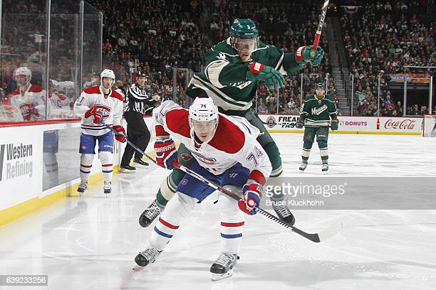 Charlie Coyle of the Minnesota Wild collides with Alexei Emelin of the Montreal Canadiens during the game on January 12 2017 at the Xcel Energy...