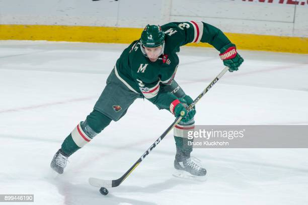 Charlie Coyle of the Minnesota Wild handles the puck against the Edmonton Oilers during the game at the Xcel Energy Center on December 16 2017 in St...