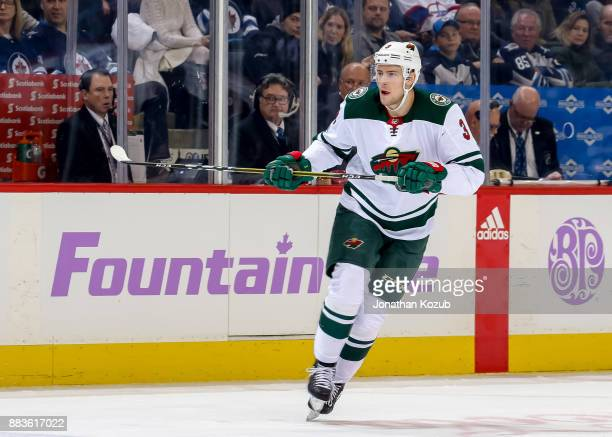 Charlie Coyle of the Minnesota Wild keeps an eye on the play during first period action against the Winnipeg Jets at the Bell MTS Place on November...