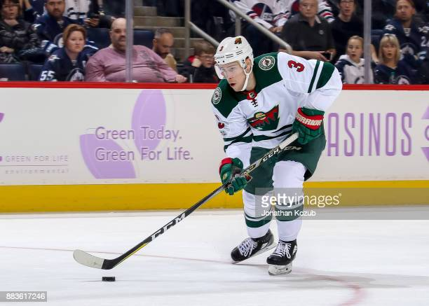 Charlie Coyle of the Minnesota Wild plays the puck down the ice during first period action against the Winnipeg Jets at the Bell MTS Place on...