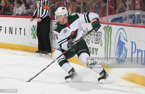 Charlie Coyle of the Minnesota Wild plays the puck during the game against the New Jersey Devils at Prudential Center on February 9 2019 in Newark...