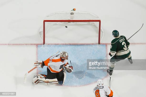 Charlie Coyle of the Minnesota Wild scores a goal against goalie Ray Emery of the Philadelphia Flyers during the game on December 2 2013 at the Xcel...