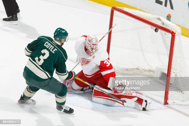Charlie Coyle of the Minnesota Wild scores a goal against Jared Coreau of the Detroit Red Wings during the game on February 12 2017 at the Xcel...