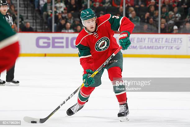 Charlie Coyle of the Minnesota Wild shoots he puck against the Calgary Flames during the game on November 15 2016 at the Xcel Energy Center in St...