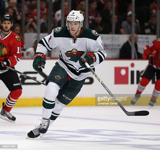 Charlie Coyle of the Minnesota Wild skates against the Chicago Blackhawks closes in during Game Two of the Second Round of the 2014 NHL Stanley Cup...