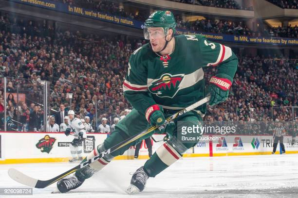 Charlie Coyle of the Minnesota Wild skates against the San Jose Sharks during the game at the Xcel Energy Center on February 25 2018 in St Paul...