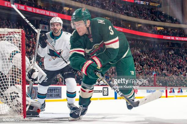 Charlie Coyle of the Minnesota Wild skates to the puck against the San Jose Sharks during the game at the Xcel Energy Center on February 25 2018 in...