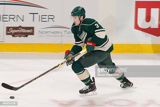 Charlie Coyle of the Minnesota Wild skates with the puck against the Boston Bruins during the game on December 17 2014 at the Xcel Energy Center in...