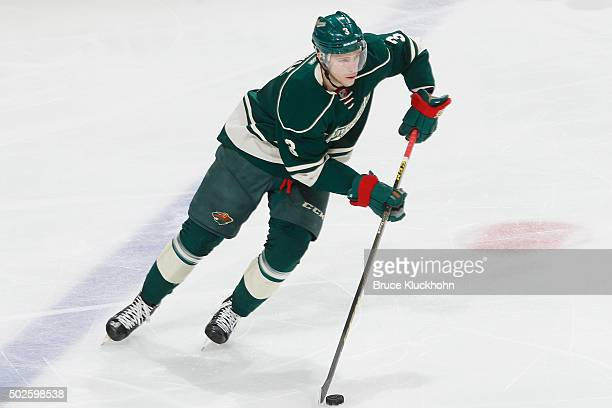 Charlie Coyle of the Minnesota Wild skates with the puck against the New York Rangers during the game on December 17 2015 at the Xcel Energy Center...