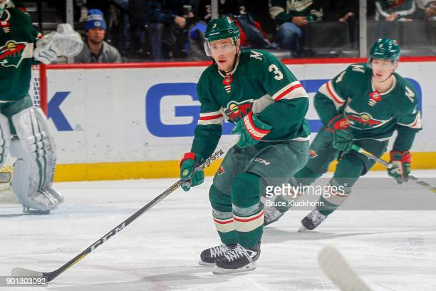 Charlie Coyle of the Minnesota Wild skates with the puck against the Dallas Stars during the game at the Xcel Energy Center on December 27 2017 in St...