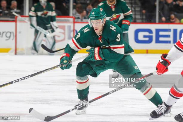 Charlie Coyle of the Minnesota Wild skates with the puck against the Carolina Hurricanes during the game at the Xcel Energy Center on March 6 2018 in...