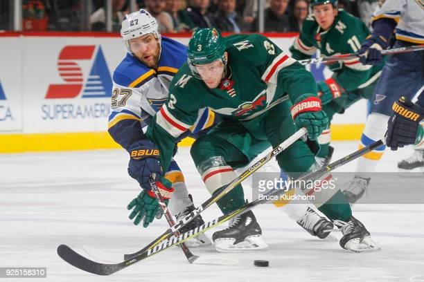 Charlie Coyle of the Minnesota Wild skates with the puck while Alex Pietrangelo of the St Louis Blues defends during the game at the Xcel Energy...