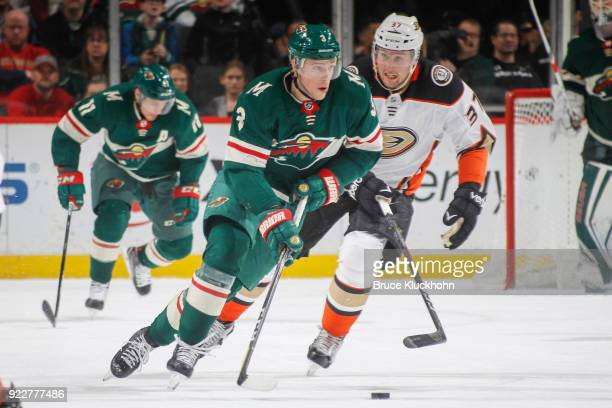Charlie Coyle of the Minnesota Wild skates with the puck while Nick Ritchie of the Anaheim Ducks defends during the game at the Xcel Energy Center on...