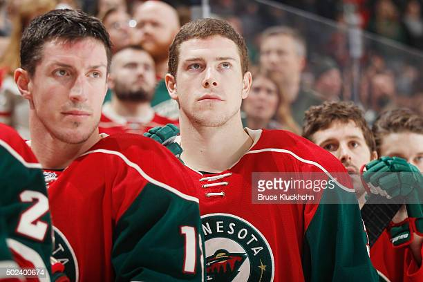 Charlie Coyle of the Minnesota Wild stands during the national anthem prior to the game against the Vancouver Canucks on December 15 2015 at the Xcel...