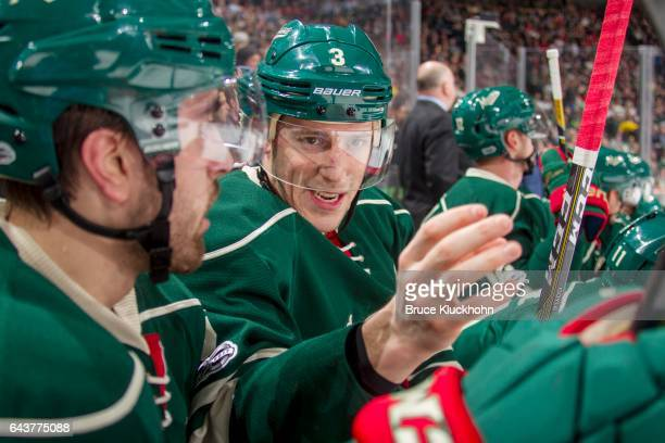 Charlie Coyle of the Minnesota Wild talks with a teammate during the game against the Dallas Stars on February 16 2017 at the Xcel Energy Center in...