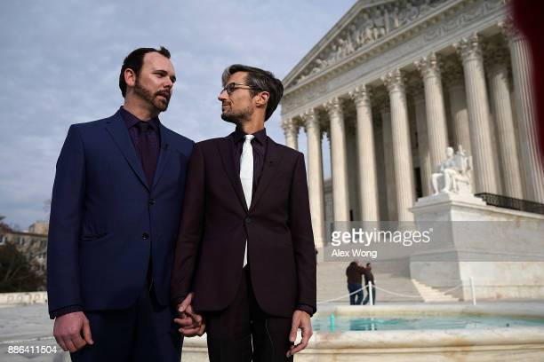 Charlie Craig and Dave Mullins the gay couple who were denied having their wedding cake baked by cake artist Jack Phillips look at each other during...