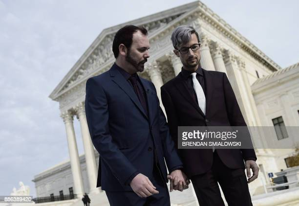 Charlie Craig and his spouse Dave Mullins hold hands outside the US Supreme Court as Masterpiece Cakeshop vs Colorado Civil Rights Commission is...