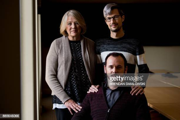 Charlie Craig poses with his mother Debbie Munn and husband Dave Mullins pose before Masterpiece Cakeshop vs Colorado is heard before US Supreme...