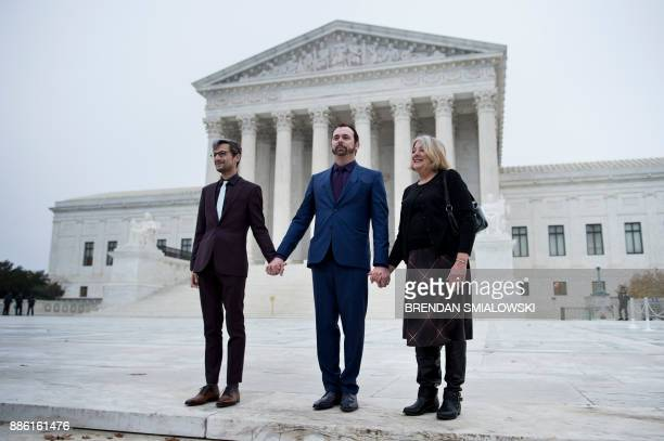 Charlie Craig stands with his mother Debbie Munn and his spouse Dave Mullins outside the US Supreme Court before Masterpiece Cakeshop vs Colorado...
