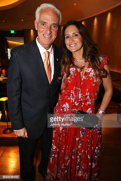 Charlie Crist and Carol Crist attend Fete De La Plage presented by Goddessey Boutique at The Edition on December 4 in Miami Beach Florida