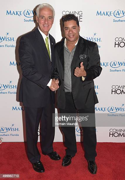 Charlie Crist and Rich Santelises attends Coming Home and MakeAWish Southern Florida Celebrate Miami Art Design Week at Coming Home Gallery on...