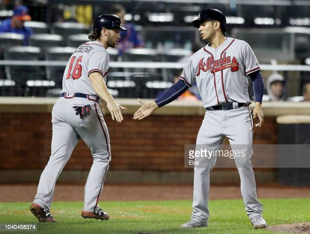 Charlie Culberson and Rio Ruiz of the Atlanta Braves celebrate after they scored in the seventh inning against the New York Mets on September 252018...
