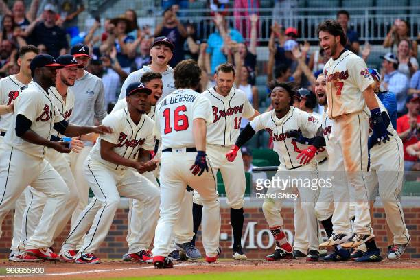 Charlie Culberson of the Atlanta Braves celebrates a walk off home run in the ninth inning against the Washington Nationals at SunTrust Park on June...