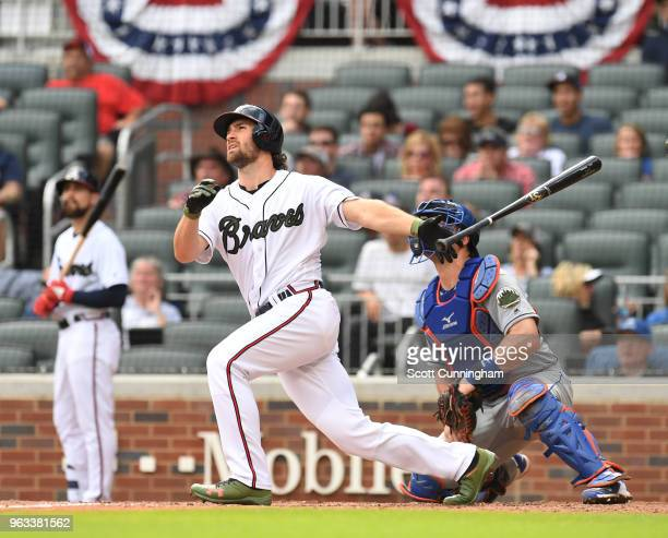 Charlie Culberson of the Atlanta Braves hits the gamewinning pinchhit two run home run in the ninth inning against the New York Mets at SunTrust...