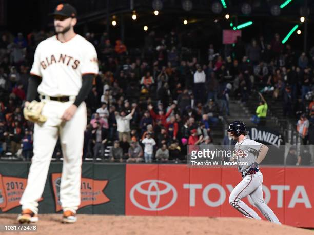 Charlie Culberson of the Atlanta Braves trots around the bases after hitting a tworun home run off of Andrew Suarez of the San Francisco Giants in...