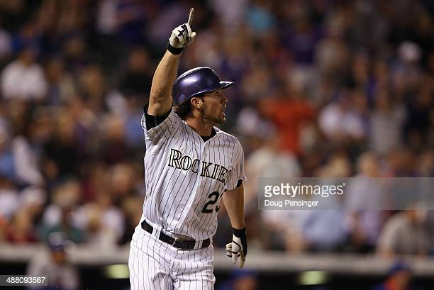 Charlie Culberson of the Colorado Rockies celebrates his game winning walk off two run pinch hit home run off of Kyle Farnsworth of the New York Mets...