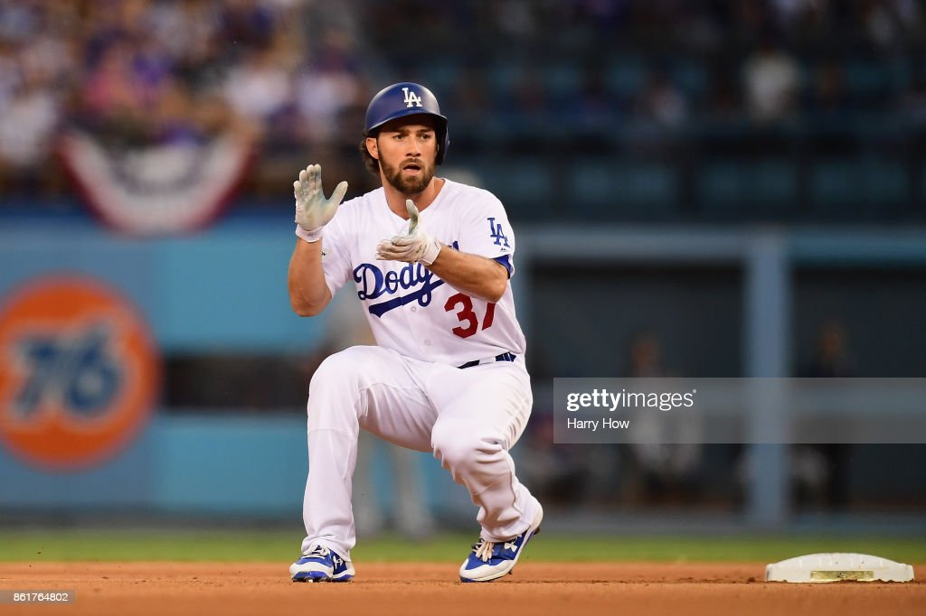 Charlie Culberson #37 of the Los Angeles Dodgers celebrates after hitting a double in the fifth inning against the Chicago Cubs during game two of the National League Championship Series at Dodger Stadium on October 15, 2017 in Los Angeles, California.