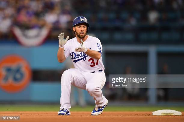 Charlie Culberson of the Los Angeles Dodgers celebrates after hitting a double in the fifth inning against the Chicago Cubs during game two of the...