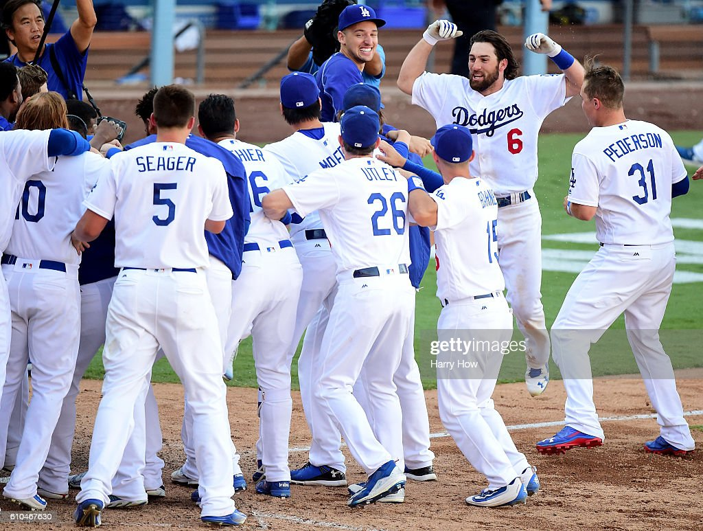 Charlie Culberson #6 of the Los Angeles Dodgers celebrates his solo homerun for a 4-3 win over the Colorado Rockies during the tenth inning at Dodger Stadium on September 25, 2016 in Los Angeles, California. The Los Angeles Dodgers clinch the division with the win.