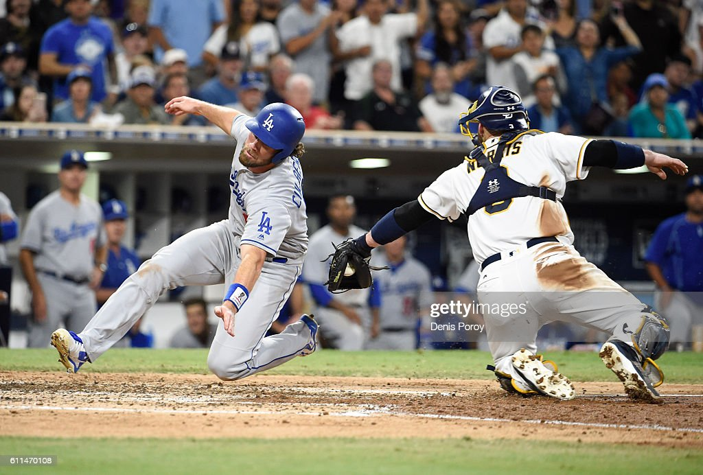 Charlie Culberson #6 of the Los Angeles Dodgers scores ahead of the tag of Derek Norris #3 of the San Diego Padres during the sixth inning of a baseball game at PETCO Park on September 29, 2016 in San Diego, California.