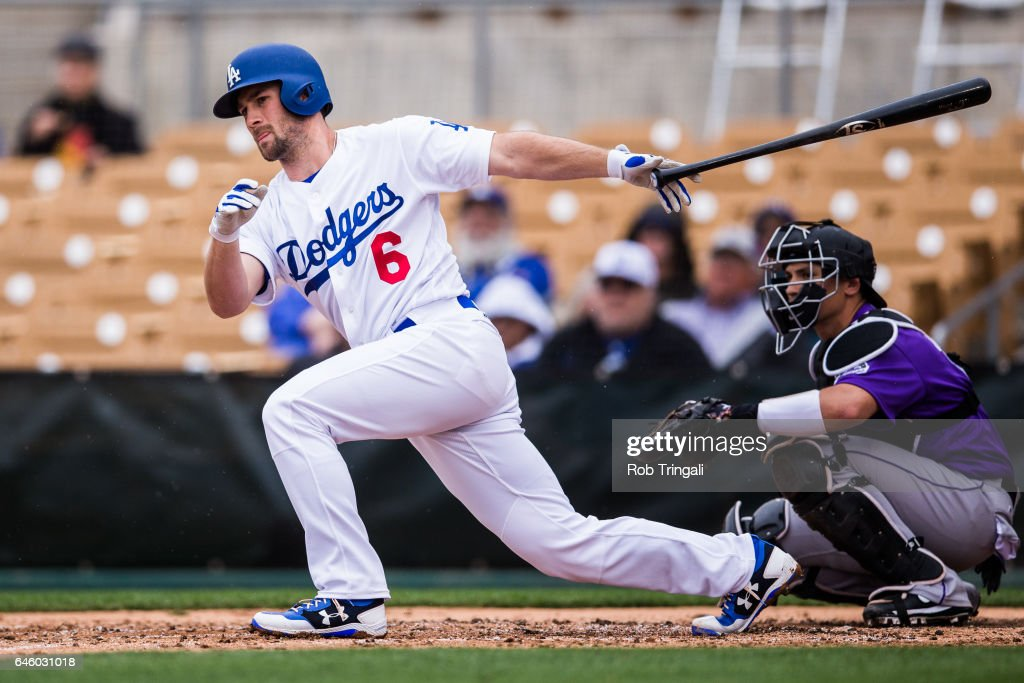 Charlie Culberson #6 of the Los Angeles Dodgers singles in the third inning during a spring training game against the Colorado Rockies at Camelback Ranch on February 27, 2017 in Glendale, Arizona.