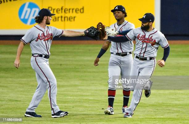 Charlie Culberson Ronald Acuna Jr #13 and Nick Markakis of the Atlanta Braves celebrate the win against the Miami Marlins at Marlins Park on June 8...