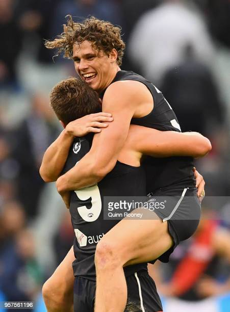 Charlie Curnow and Patrick Cripps of the Blues celebrate winning the round eight AFL match between the Carlton Blues and the Essendon Bombers at...