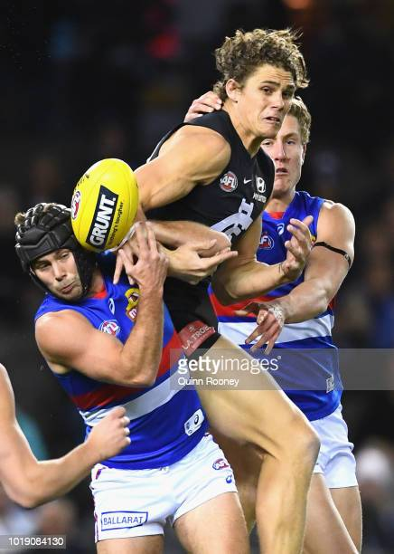 Charlie Curnow of the Blues and Caleb Daniel of the Bulldogs compete for a mark during the round 22 AFL match between the Carlton Blues and the...