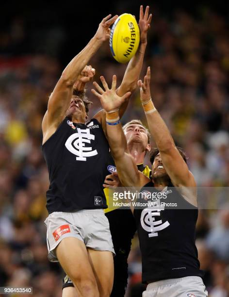 Charlie Curnow of the Blues and Levi Casboult of the Blues compete for the ball against David Astbury of the Tigers during the 2018 AFL round 01...