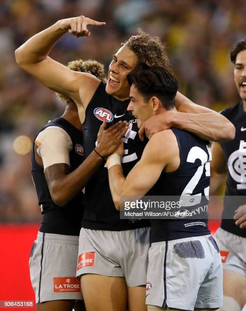 Charlie Curnow of the Blues and teammate Zac Fisher of the Blues celebrate during the 2018 AFL round 01 match between the Richmond Tigers and the...