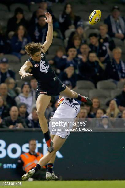 Charlie Curnow of the Blues attempts to mark the ball during the round 23 AFL match between the Carlton Blues and the Adelaide Crows at Etihad...