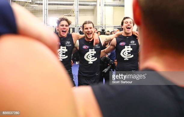 Charlie Curnow of the Blues Bryce Gibbs of the Blues and their teammates sing the song in the rooms after winning during the round 22 AFL match...