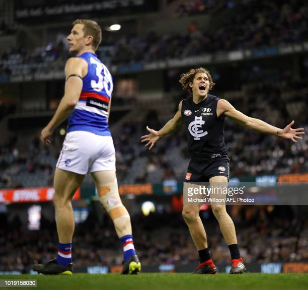 Charlie Curnow of the Blues celebrates a goal during the 2018 AFL round 22 match between the Carlton Blues and the Western Bulldogs at Etihad Stadium...