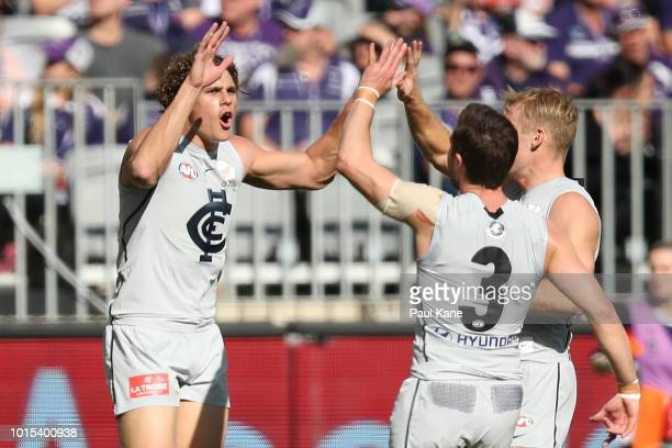 Charlie Curnow of the Blues celebrates a goal during the round 21 AFL match between the Fremantle Dockers and the Carlton Blues at Optus Stadium on...