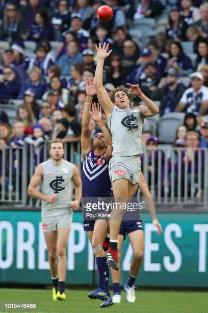 Charlie Curnow of the Blues contests for a mark against Michael Johnson of the Dockers during the round 21 AFL match between the Fremantle Dockers...