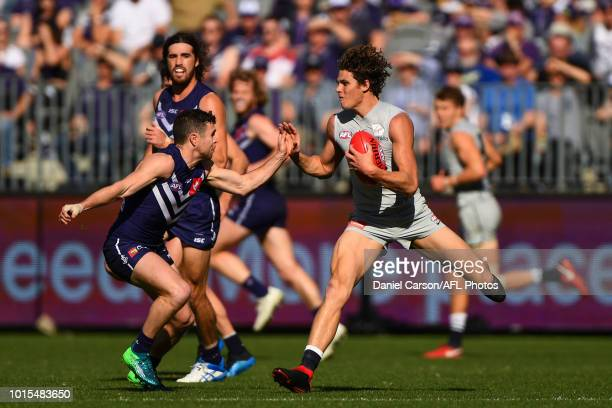 Charlie Curnow of the Blues fends off Hayden Ballantyne of the Dockers during the 2018 AFL round 21 match between the Fremantle Dockers and the...