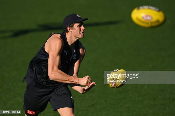 Charlie Curnow of the Blues handballs during a Carlton Blues AFL media opportunity at Ikon Park on June 21, 2021 in Melbourne, Australia.