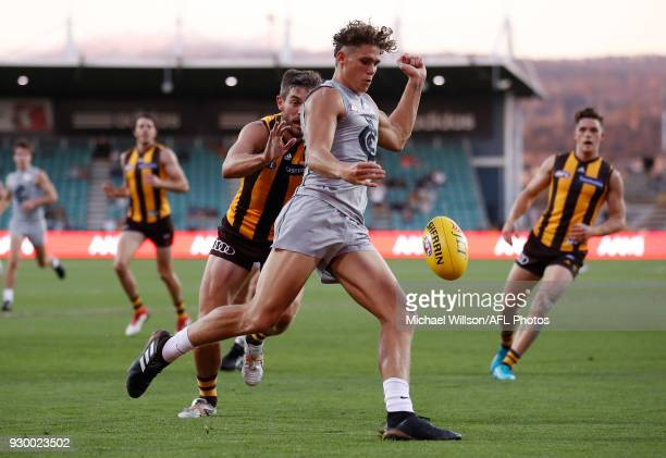 Charlie Curnow of the Blues is tackled by Ricky Henderson of the Hawks during the AFL 2018 JLT Community Series match between the Hawthorn Haws and...